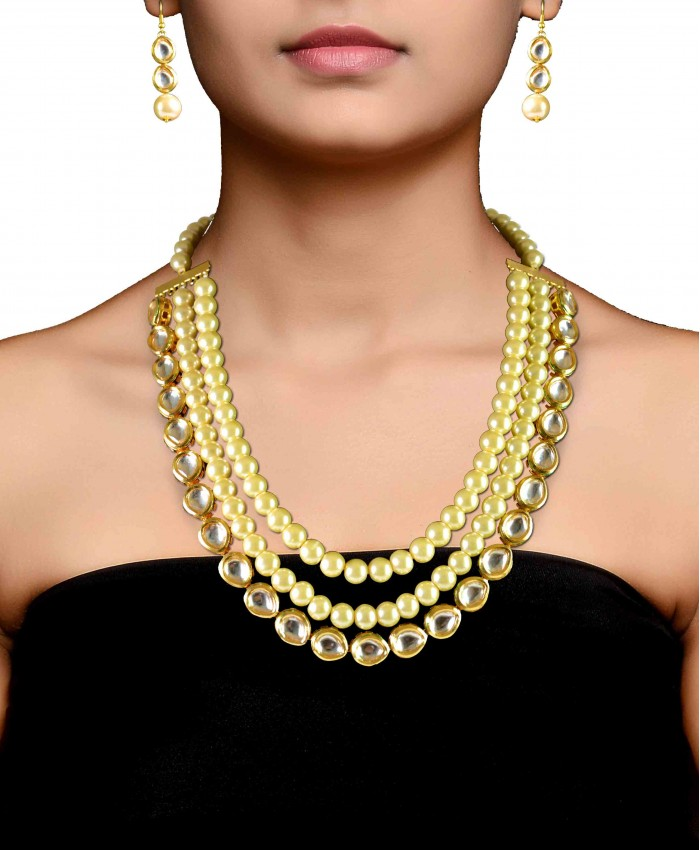 Anishka Gold Plated Kundan And Pearl Necklace Set